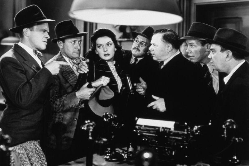 L. to R. : Frank Jenks, Roscoe Karns, Rosalind Russell, Porter Hall, Gene Lockhart, Regis Toomey & Cliff Edwards in His Girl Friday (1940)