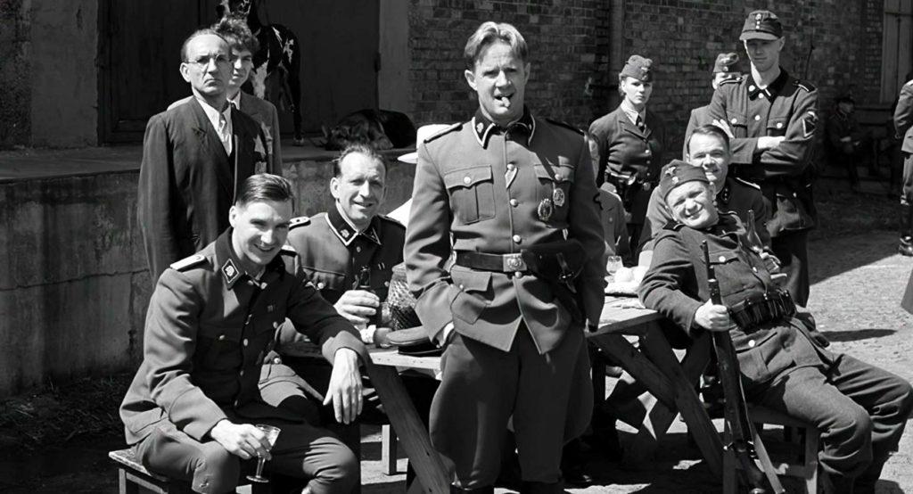 Ralph Fiennes, Ben Kingsley, Jochen Nickel, y Norbert Weisser