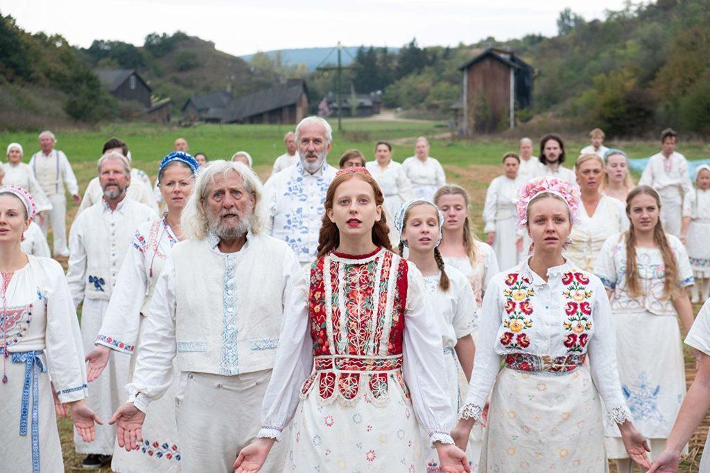 Mats Blomgren, Lars Väringer, Anna Åström, y Isabelle Grill en Midsommar (2019)